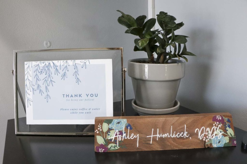 Lobby decor including a thank you for being our patient sign at Humlicek Family Dental