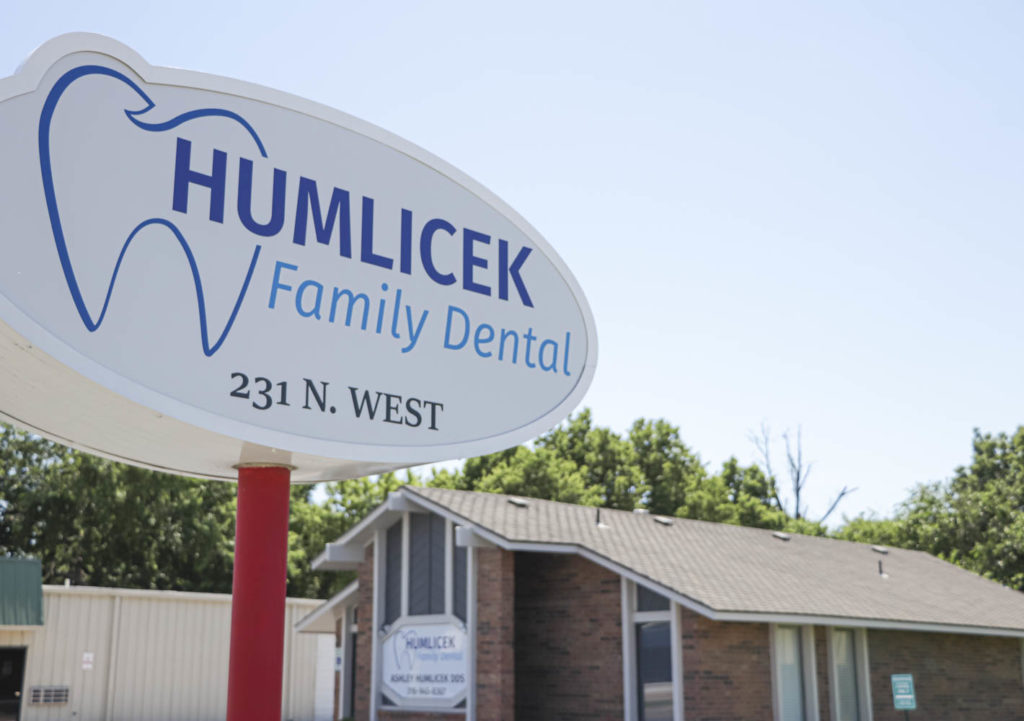 The outdoor sign and exterior of the Humlicek Family Dental office